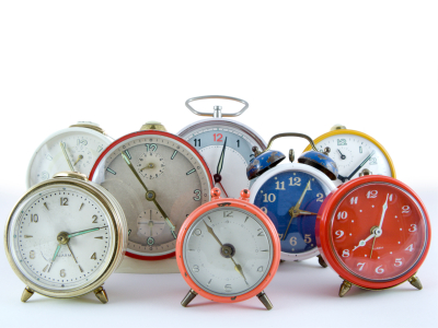 Multiple clocks in a variety of colors.